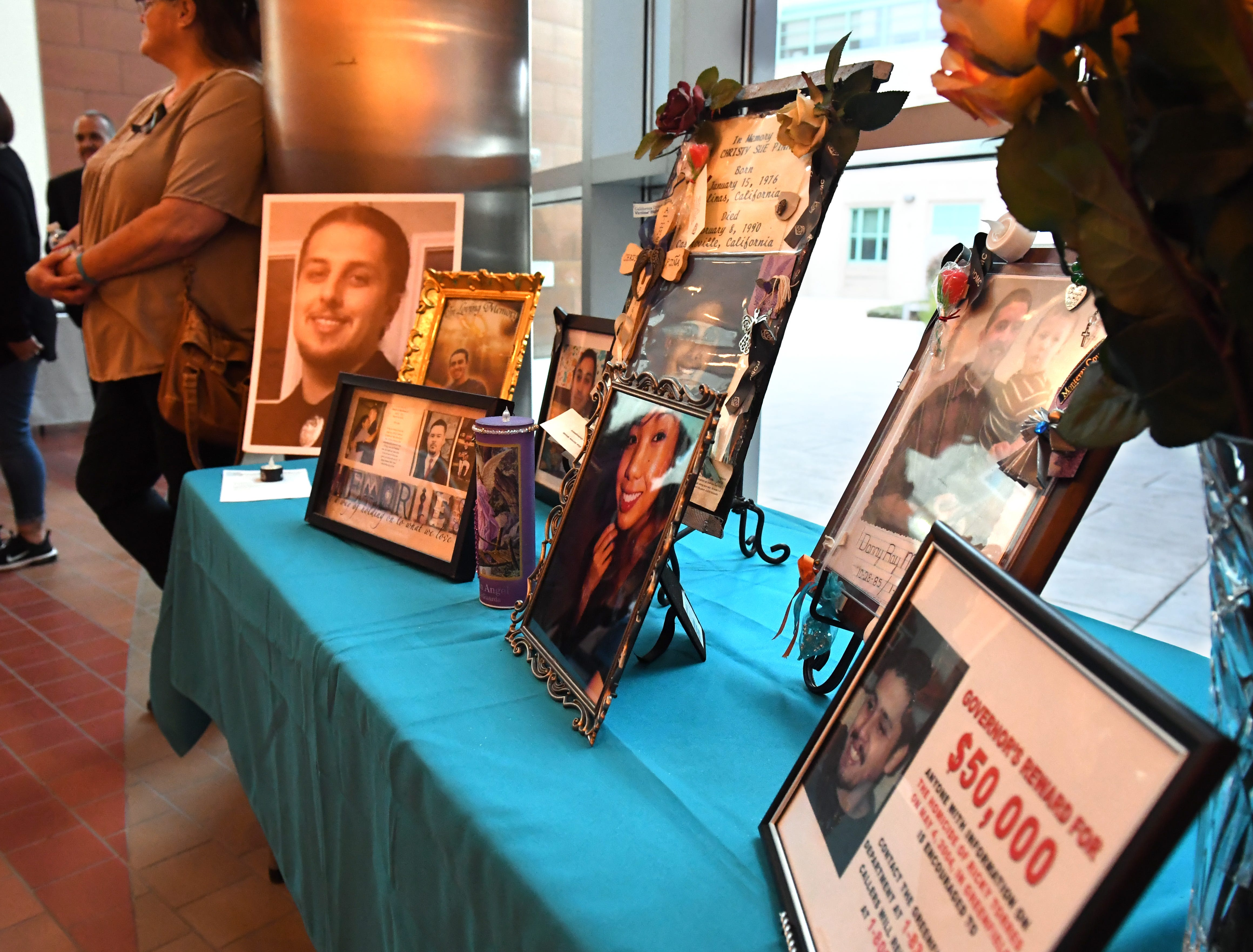 Pictures of loved ones lost to violence were on display at the National Day of Remembrance for Murder Victims ceremony Thursday.