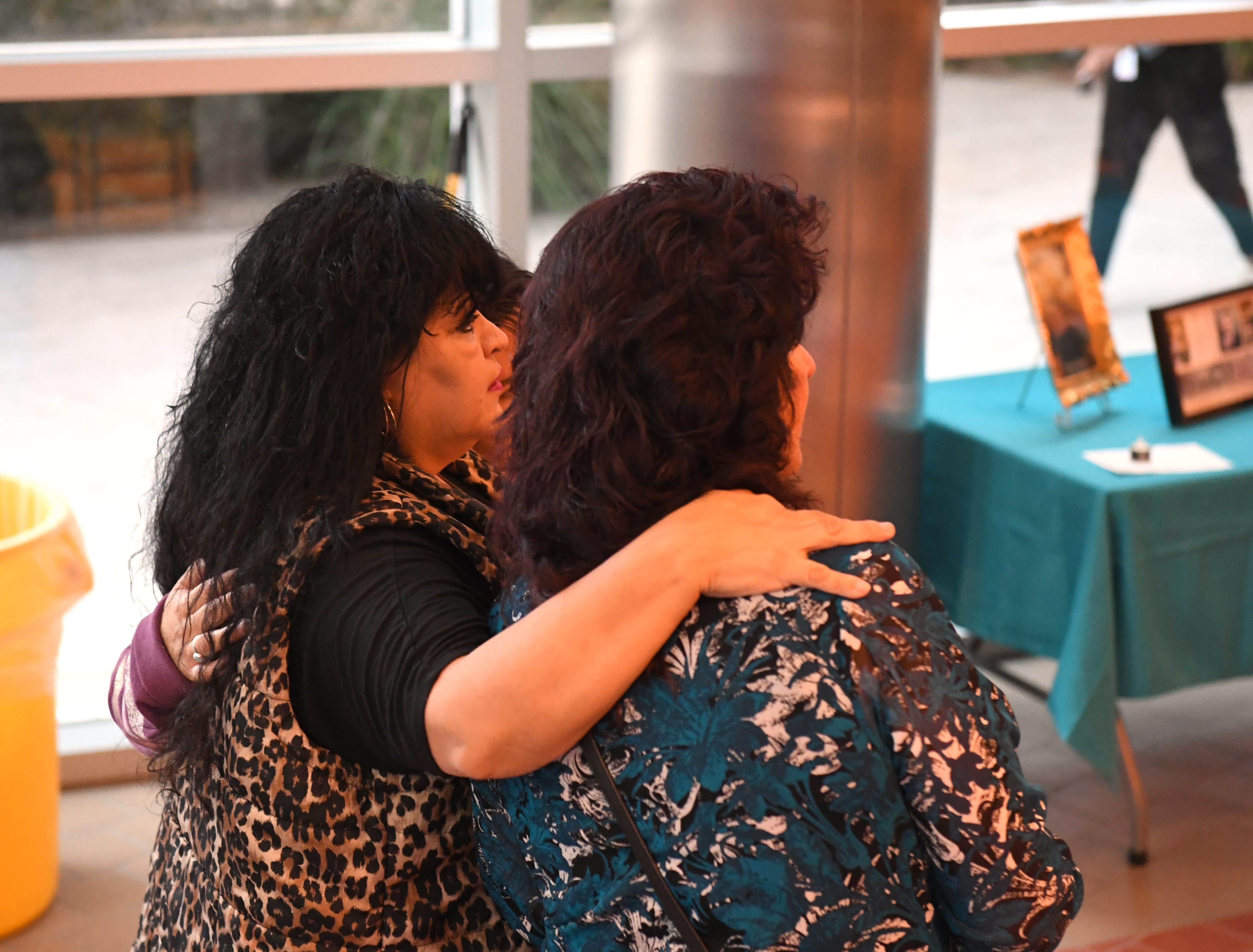 Debbie Martin hugs Emily Valdez shortly before the National Day of Remembrance for Murder  Victims ceremony Thursday
