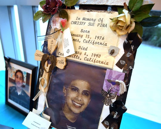 A photo honors Christy Sue Pina who was killed in 1990.