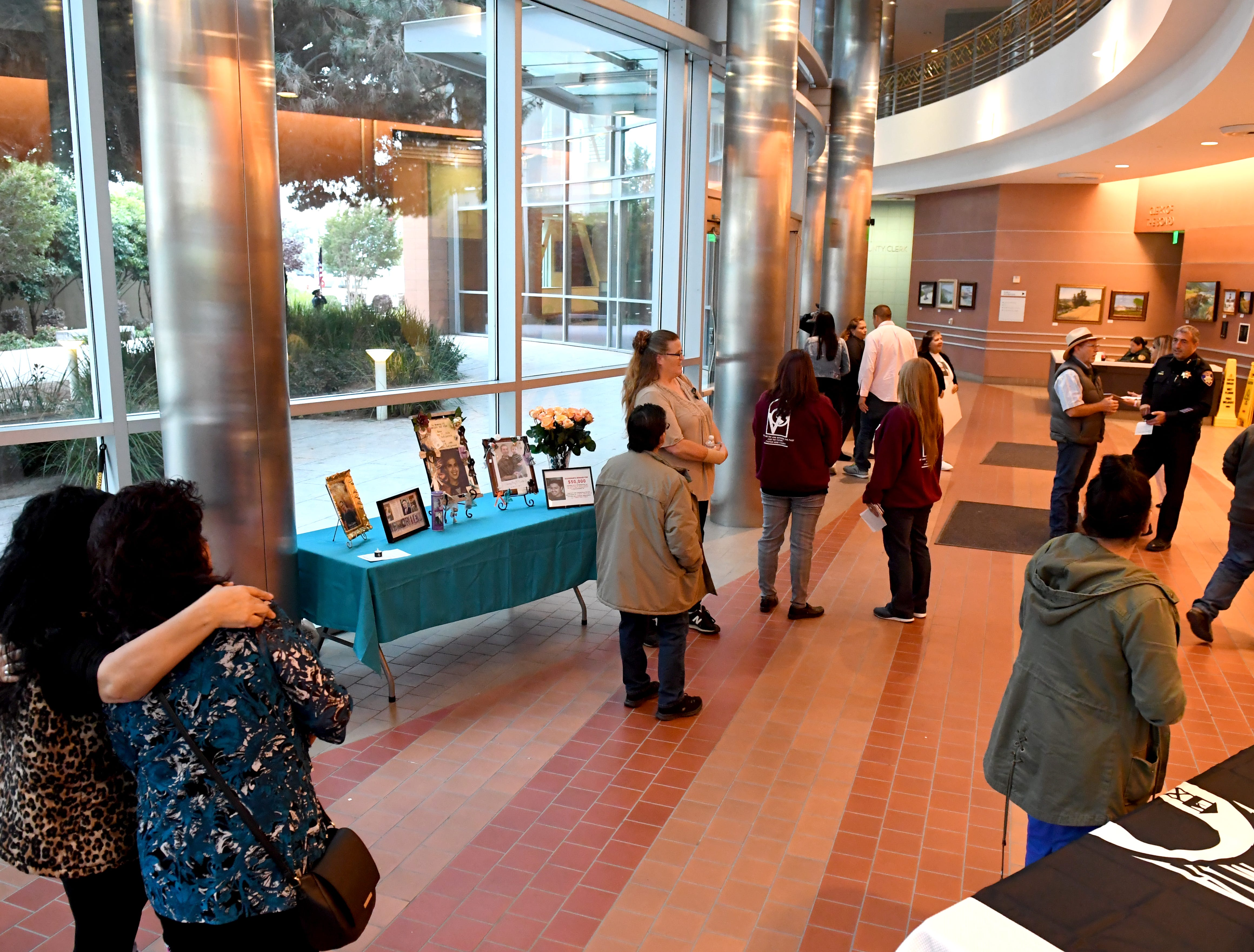 Loved ones of murder victims start to enter the Monterey County administration building for the National Day of Remembrance for Murder Victims Thursday.