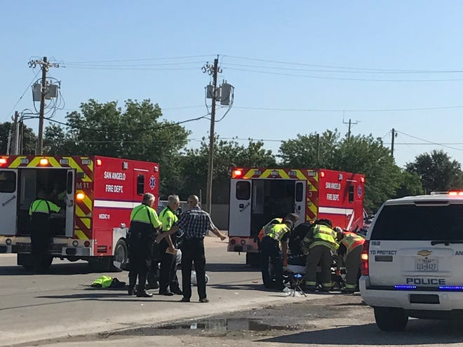 Two ambulances respond to two officers involved in a motorcycle crash on Friday, Sept. 28 in the 400 block of Pulliam Street.