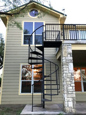 This metal spiral staircase at 1708 Catalina Drive leads to the second floor balcony.