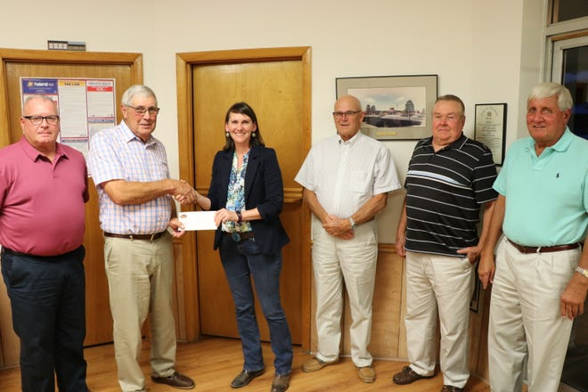 "A $210,000 check was presented recently to Selbyville town officials to help pay for road repairs. From left, are Town Councilman Richard Duncan, Mayor Clifton Murray, Mountaire's Senior Director of Processing Operations Amanda Irwin, and Councilmen Clarence ""Bud"" Tingle, Frank Smith and Jay Murray."
