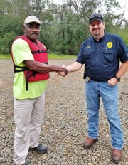 Phillip Douglas and Chief Todd Gibson.