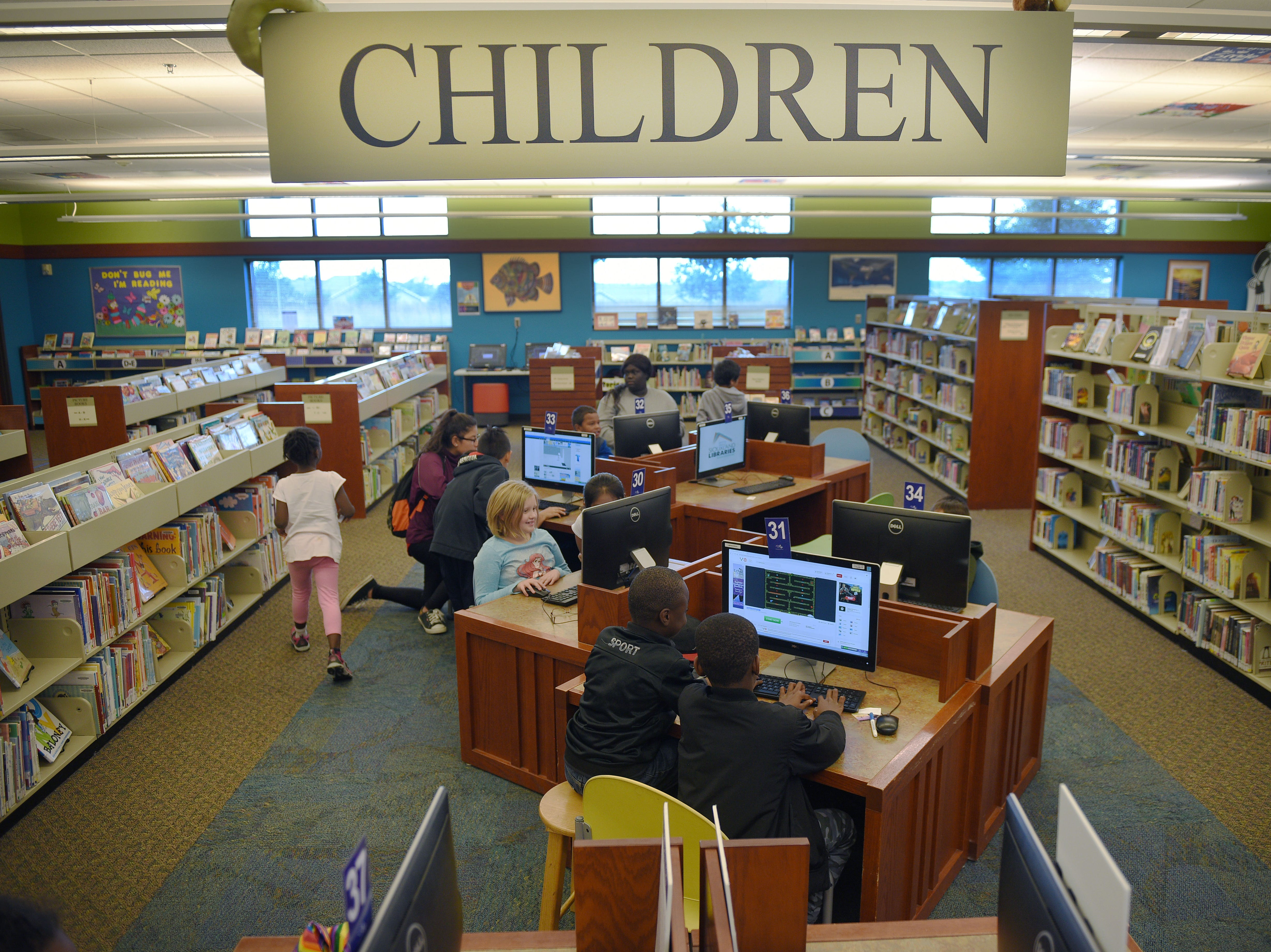 Kids go to the Oak View Library after school Wednesday, Sept 26, at the library in Sioux Falls.