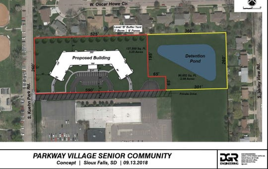 A revamped rezoning proposal heading to city planning officials Wednesday cuts one building to make room for a detention pond. It would also designate the pond area as a conservation district.