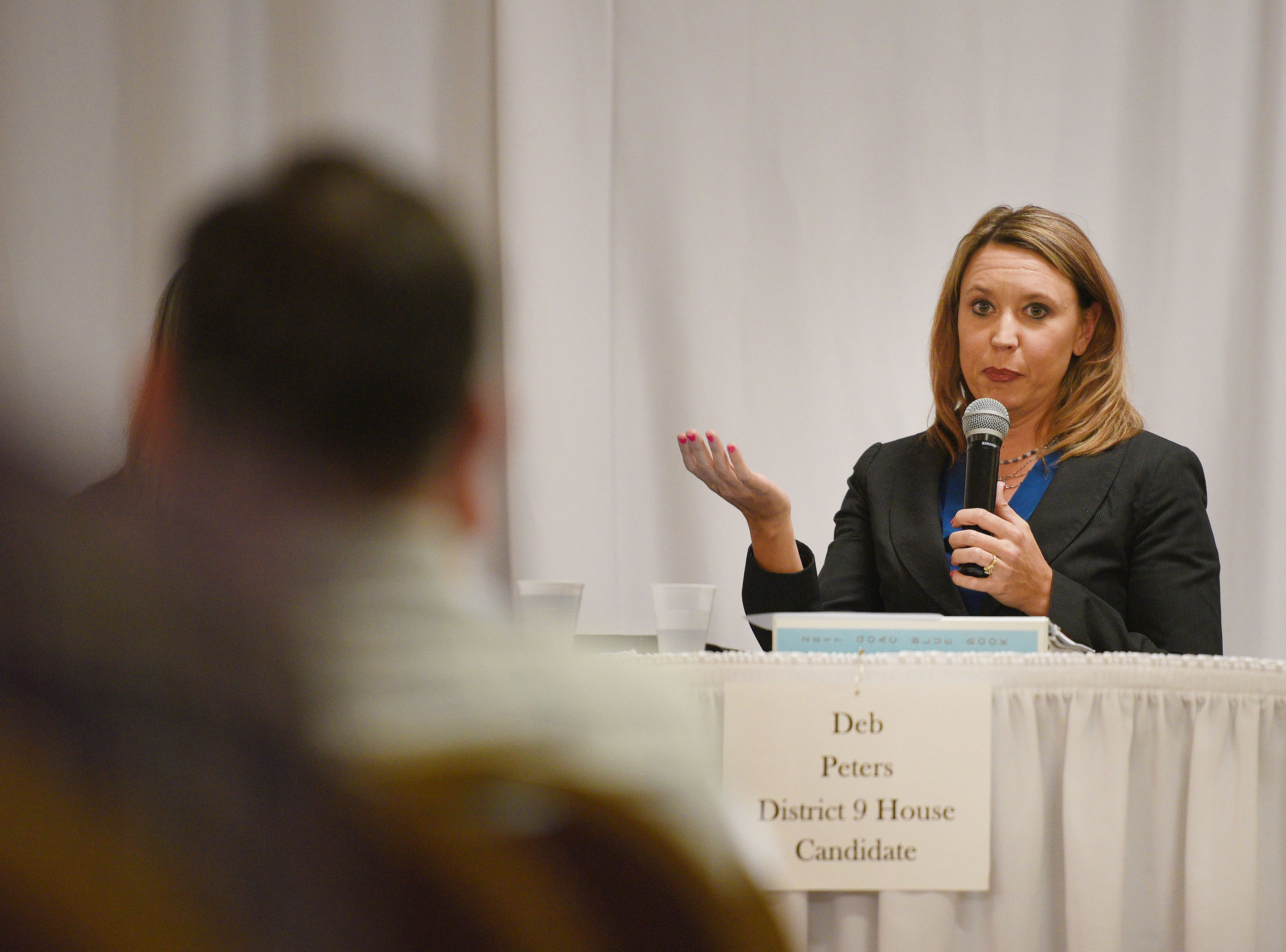 Legislative candidate Deb Peters (R) answers questions from constituents Thursday, Sept. 27, at Dakota Plains Event Center in Hartford. Candidates discussed Initiated Measure 22, health care and spending priorities.