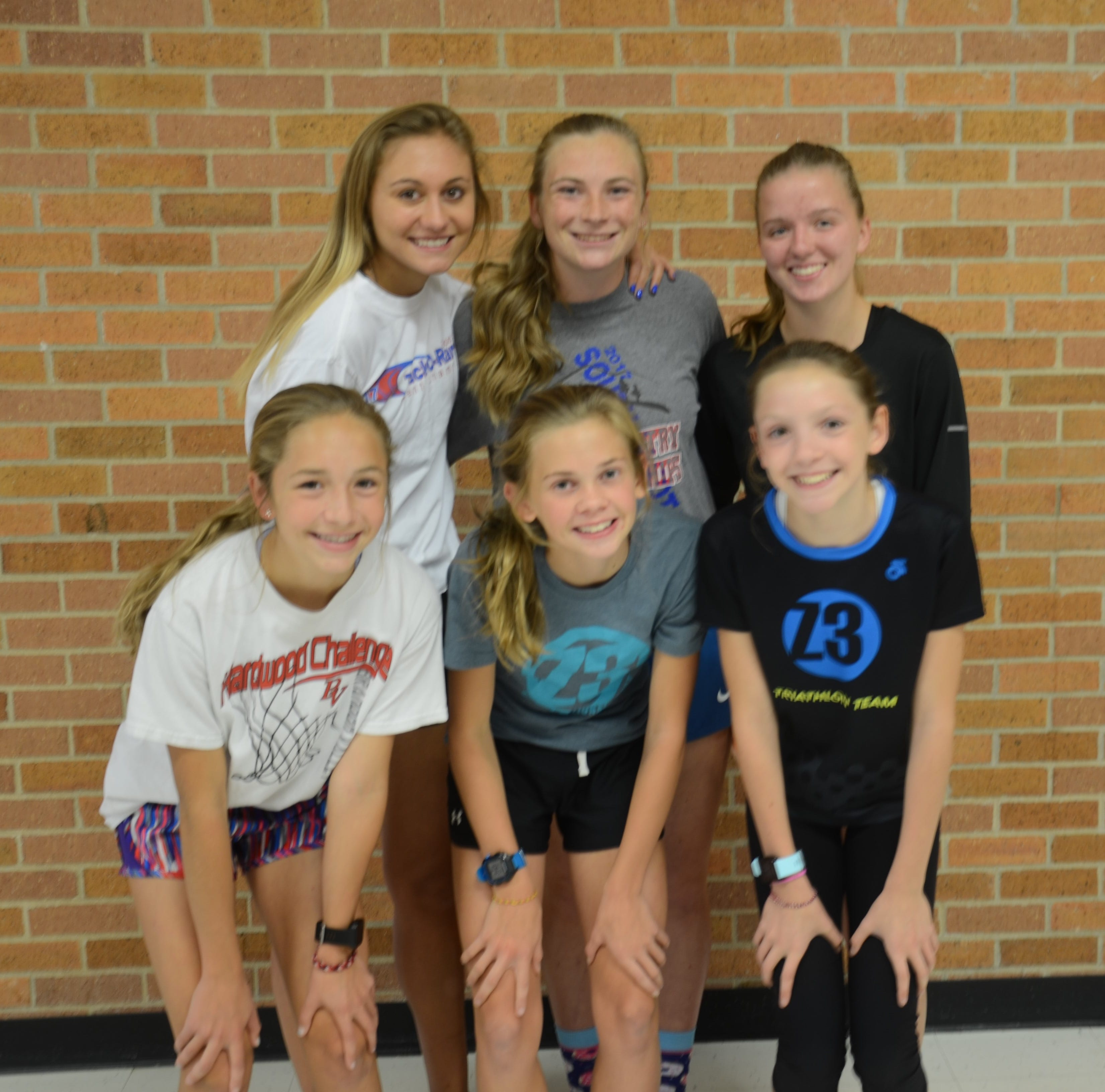 Seventh-graders are valued on varsity cross country roster