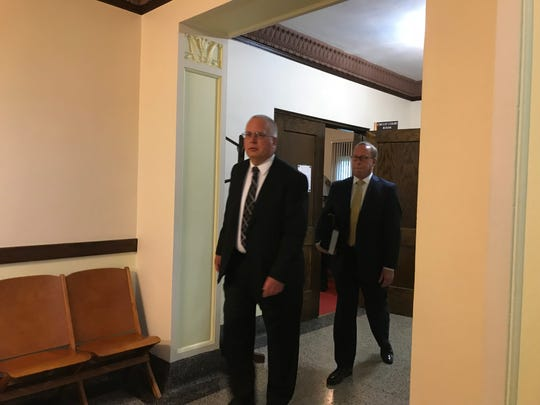 Dan Guericke, left, exits the courtroom with his attorney Mike Butler, right, Friday in Armour.