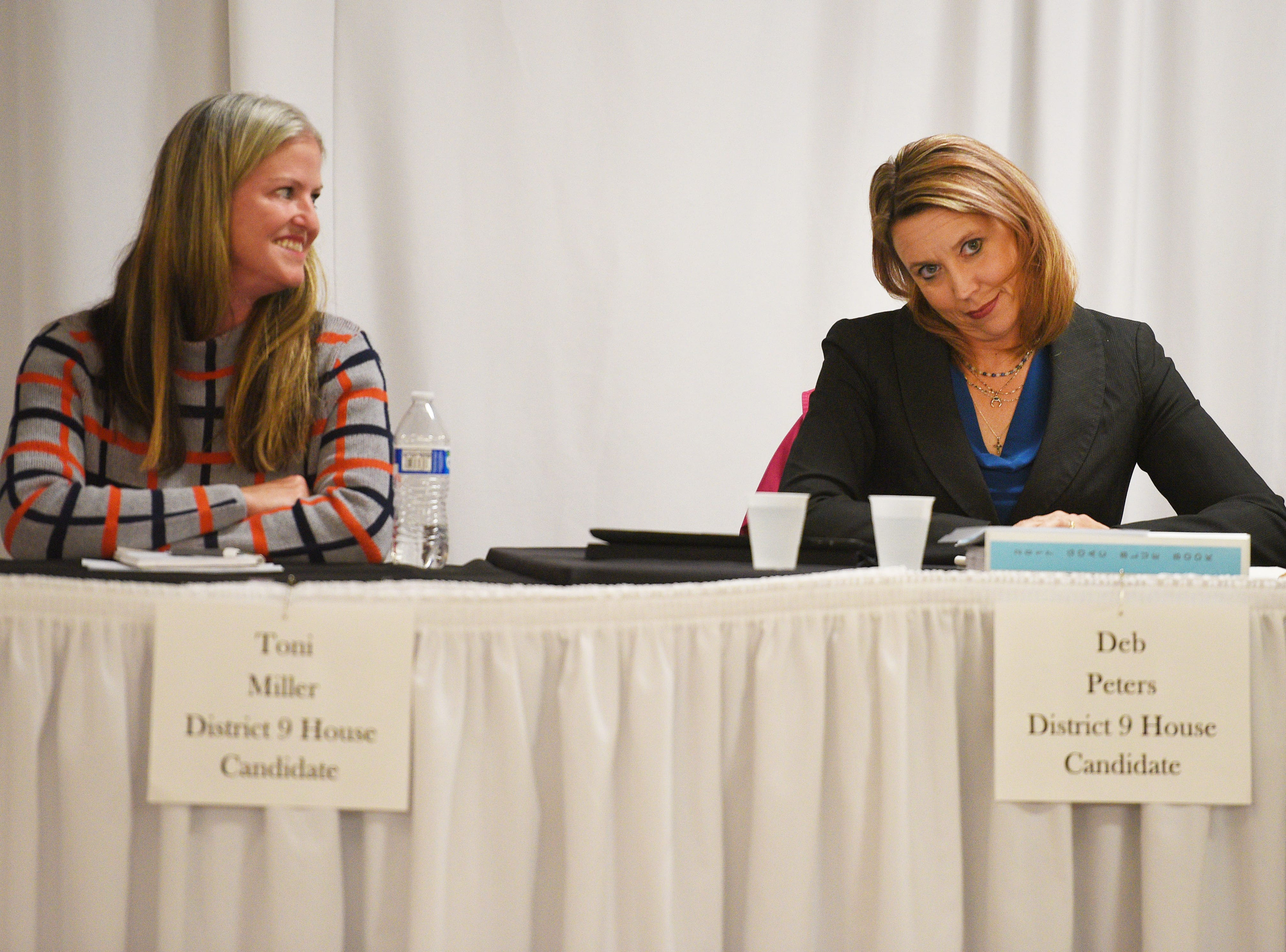 Legislative candidates Toni Miller (D) and Deb Peters (R) answers questions from constituents Thursday, Sept. 27, at Dakota Plains Event Center in Hartford. Candidates discussed Initiated Measure 22, health care and spending priorities.