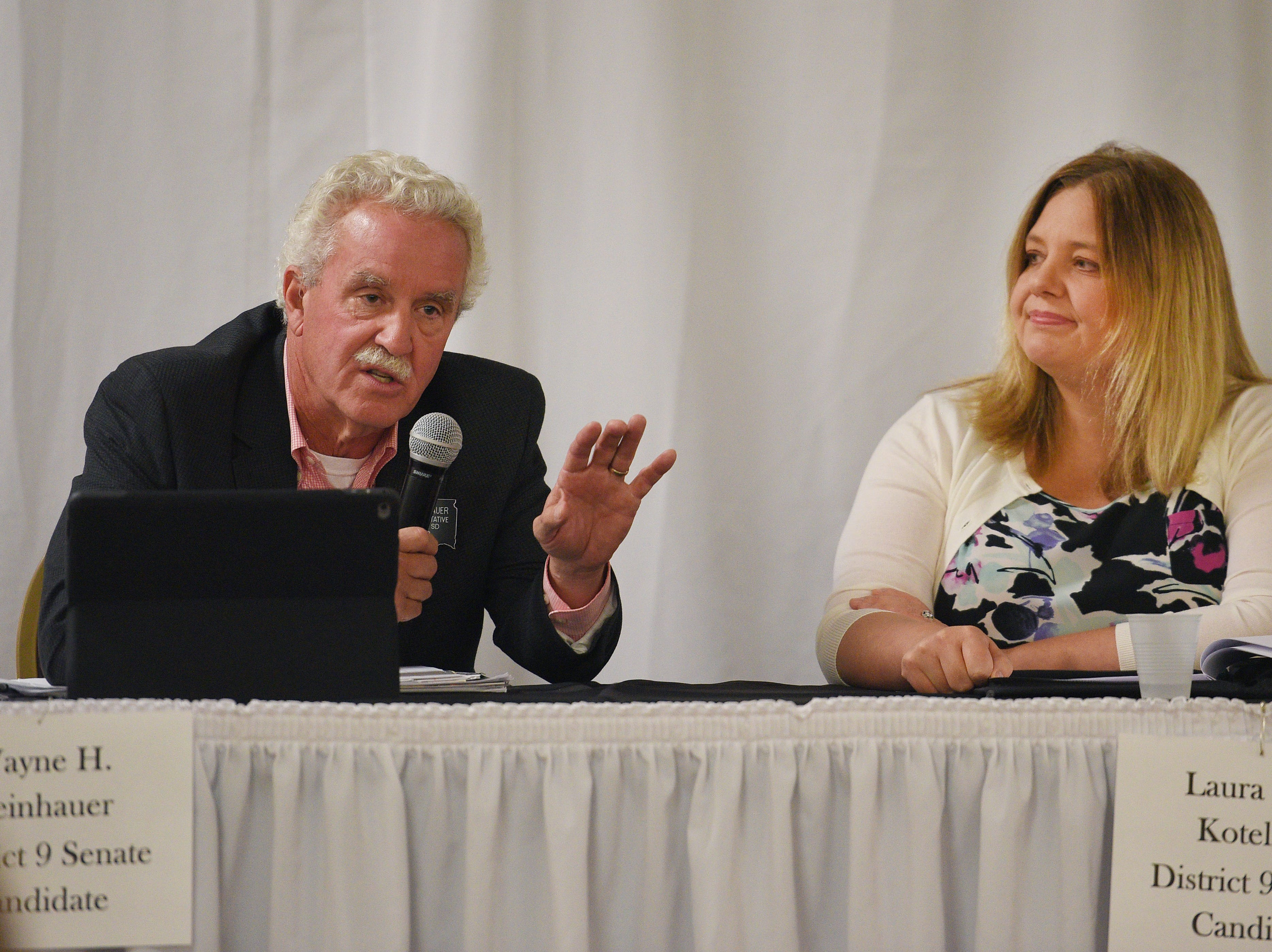 Legislative candidates Wayne Steinhauer (R) and Laura Swier Kotelman (D) answers questions from constituents Thursday, Sept. 27, at Dakota Plains Event Center in Hartford. Candidates discussed Initiated Measure 22, health care and spending priorities.