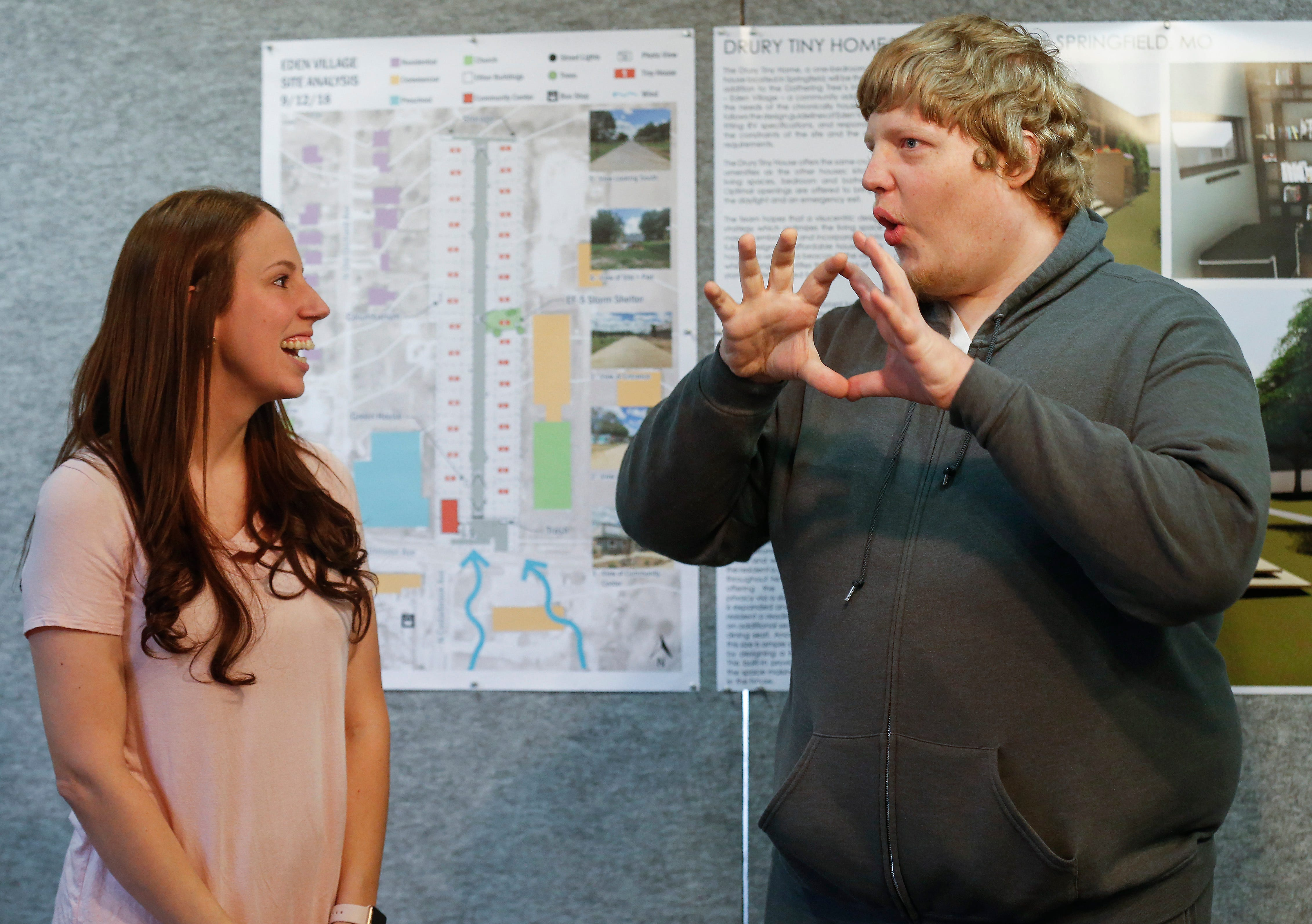 Mel Woods, right, uses sign language to talk with his friend and interpreter Tobey Wilkerson during a check presentation at Drury University for the final home in eden Village. Woods will be the final resident in the tiny home community.