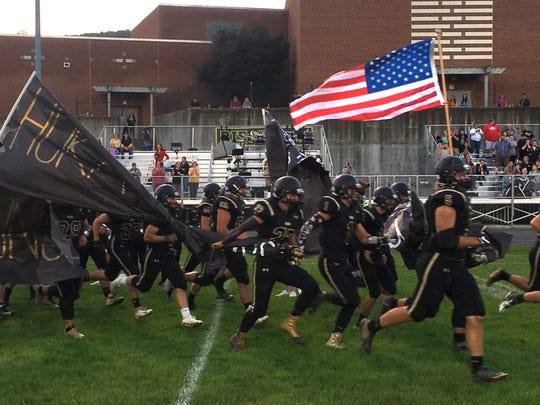 Buffalo Gap players take the field Friday before their game with Page County.