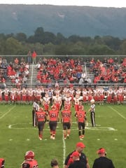 Riverheads and Stonewall Jackson take the field for the coin toss before the start of Friday night's football game.
