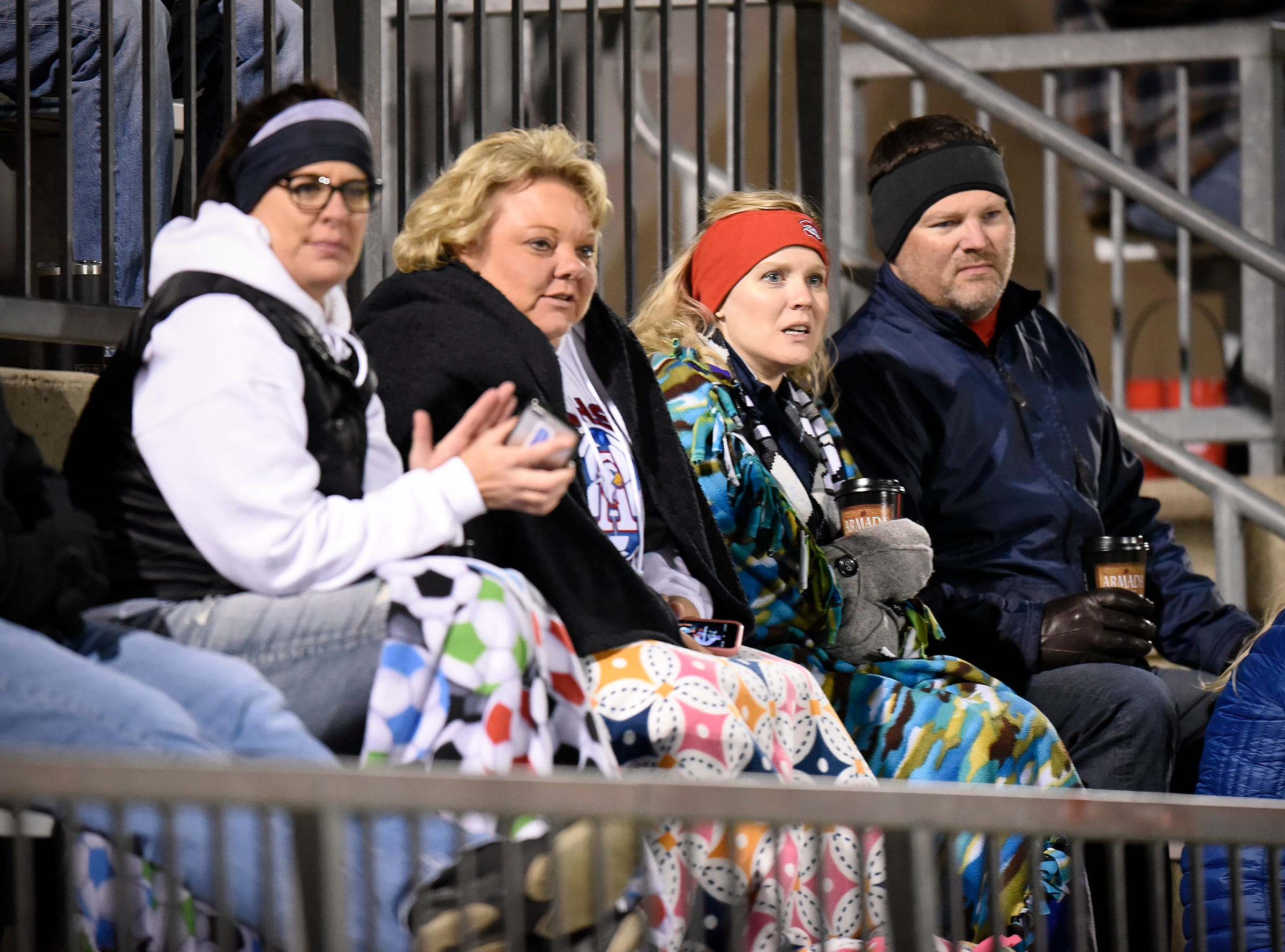 Soccer fans try and stay warm during the Tech and Apollo match Thursday, Sept. 27, at Husky Stadium.