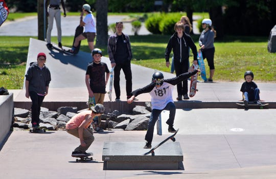 Skaters gather in small groups during a skate camp event at the St. Cloud Skate Plaza in this file photo.