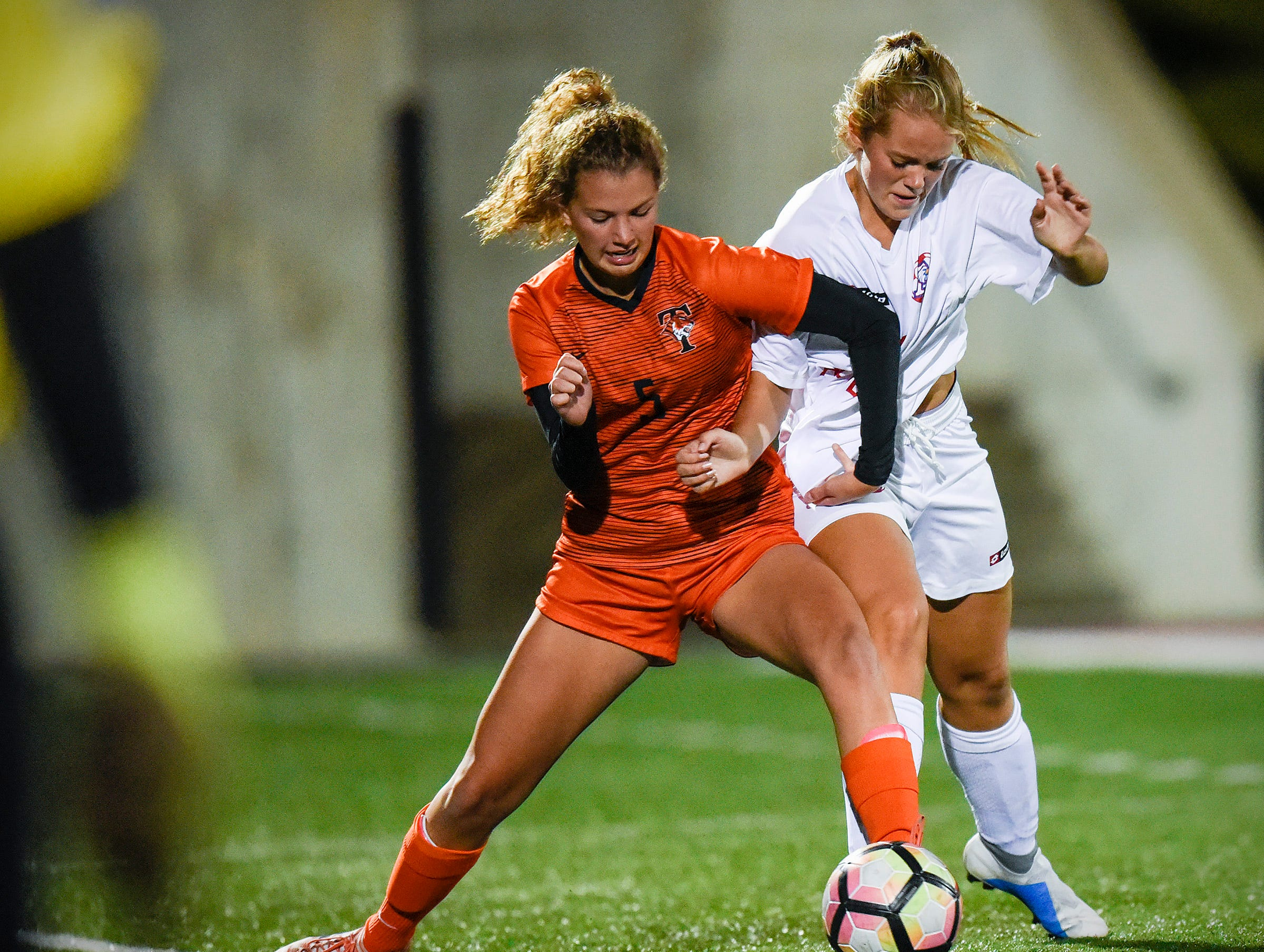 Tech's Gabrielle Rud and Apollo's Kylie Mondloch battle for the ball during the second half Thursday, Sept. 27, at Husky Stadium.