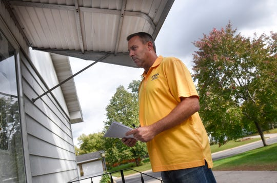 Stearns County sheriff candidate Steve Soyka waits for an answer while door knocking in the Centennial neighborhood Thursday, Sept. 27, in St. Cloud.