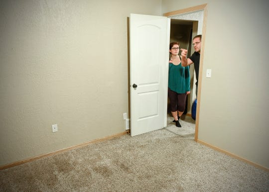 Home renters Derek and Trisha Hedburg show the basement bedroom Wednesday, Sept. 26, after the tenant recently moved out in St. Cloud. The basement tenant smoked in the room against the least agreement and after extensive cleaning still smells.