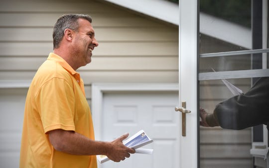 Stearns County sheriff candidate Steve Soyka talks with a resident while door knocking in the Centennial neighborhood Thursday, Sept. 27, in St. Cloud.