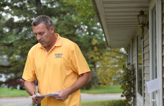 Stearns County sheriff candidate Steve Soyka walks to the next house while door knocking in the Centennial neighborhood Thursday, Sept. 27, in St. Cloud.