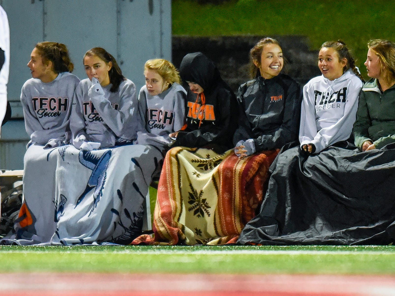 Tech players stay warm on the bench during the second half Thursday, Sept. 27, at Husky Stadium.