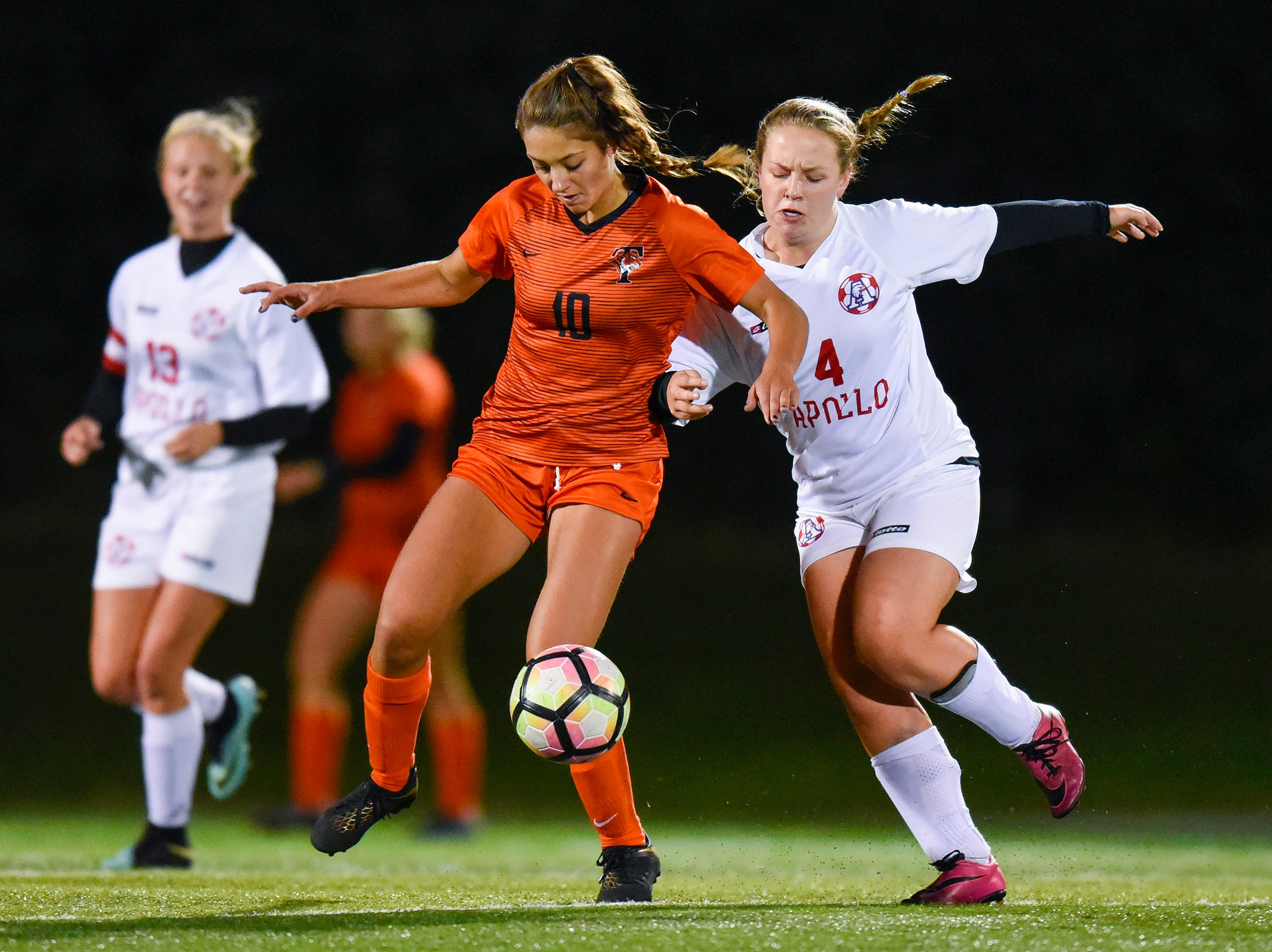 Tech's Taylor Holm and Apollo's Josie Hamre battle for the ball during the first half Thursday, Sept. 27, at Husky Stadium.