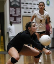 Florida High libero Mya Goodson digs a ball during the Seminoles' 3-2 win over Wakulla on Thursday.