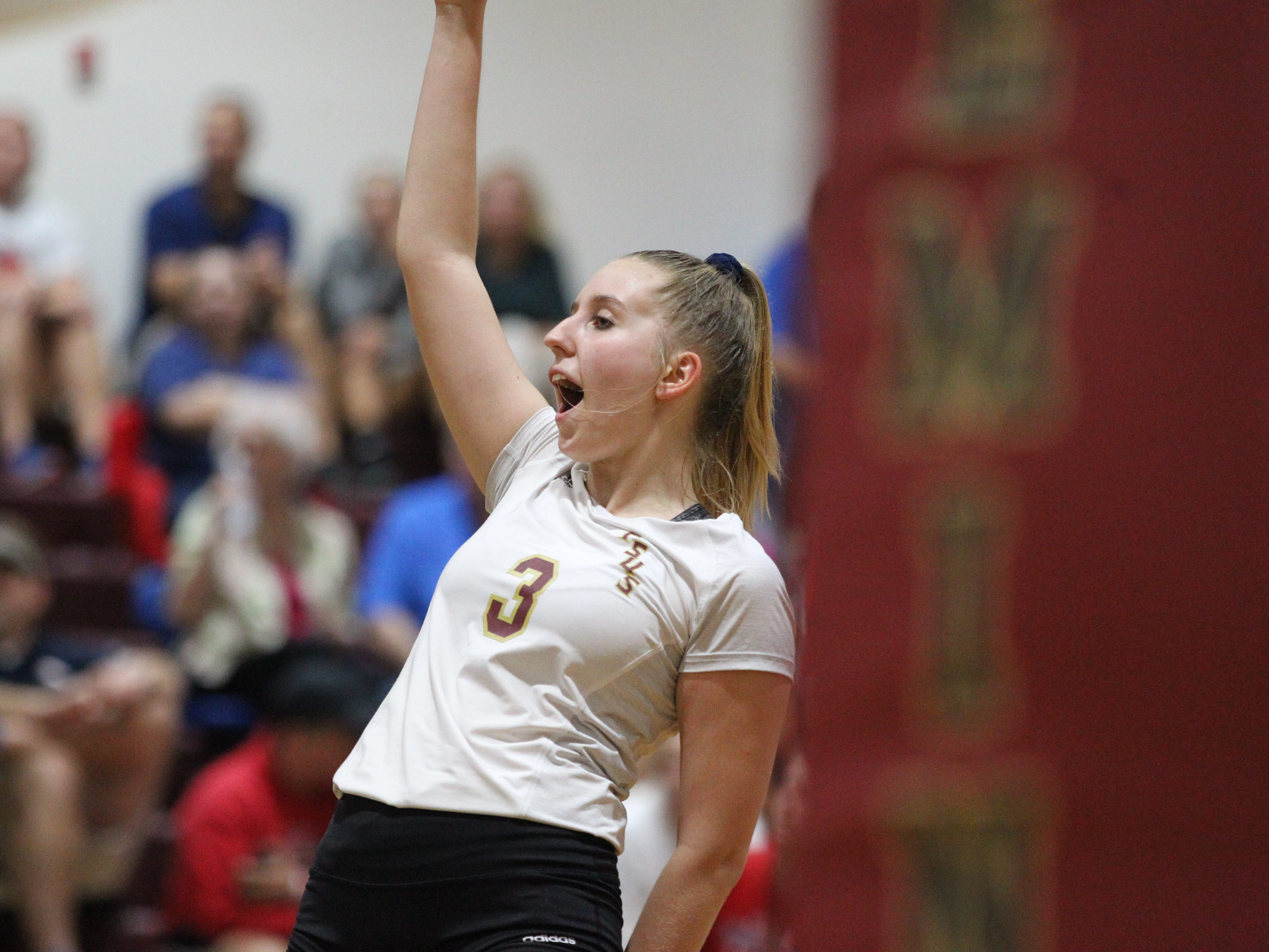 Florida High junior setter Carlee Allbaugh celebrates a point during the Seminoles' 3-2 win over Wakulla on Thursday.