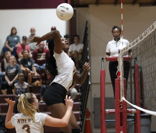 Florida High middle hitter De'Asia Hill goes for a kill during the Seminoles' 3-2 win over Wakulla on Thursday.