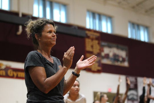 Florida High volleyball coach Sheila Roberts cheers on her team prior to beating Wakulla 3-2 on Thursday.