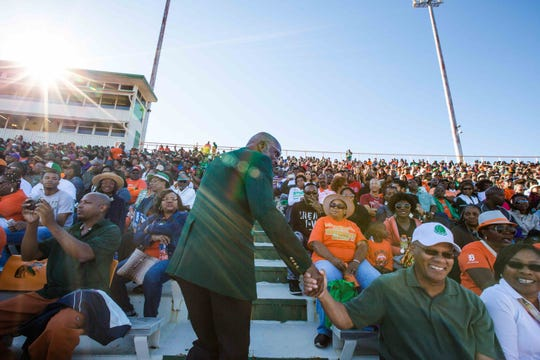 Florida A&M University President Larry Robinson greets fans during last year's Homecoming football game.