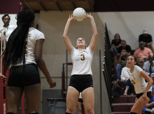 Florida High's Carlee Allbaugh sets a pass during a match against Wakulla.