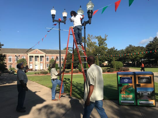 Florida A&M University employees were busy Friday morning preparing the campus for Homecoming Week.