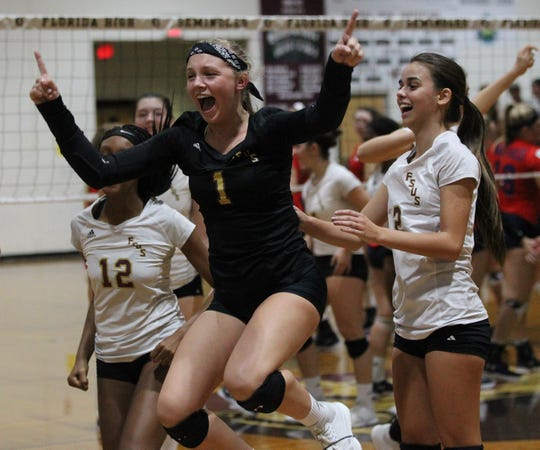 Florida High's Ashtyn Tilton celebrates as the Seminoles beat Wakulla 3-2 in a volleyball match on Thursday, Sept. 27, 2018.