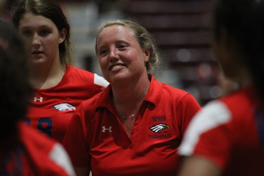 Wakulla volleyball coach Elizabeth Andrews-Potts smiles at her team's play during a game at Florida High last week.
