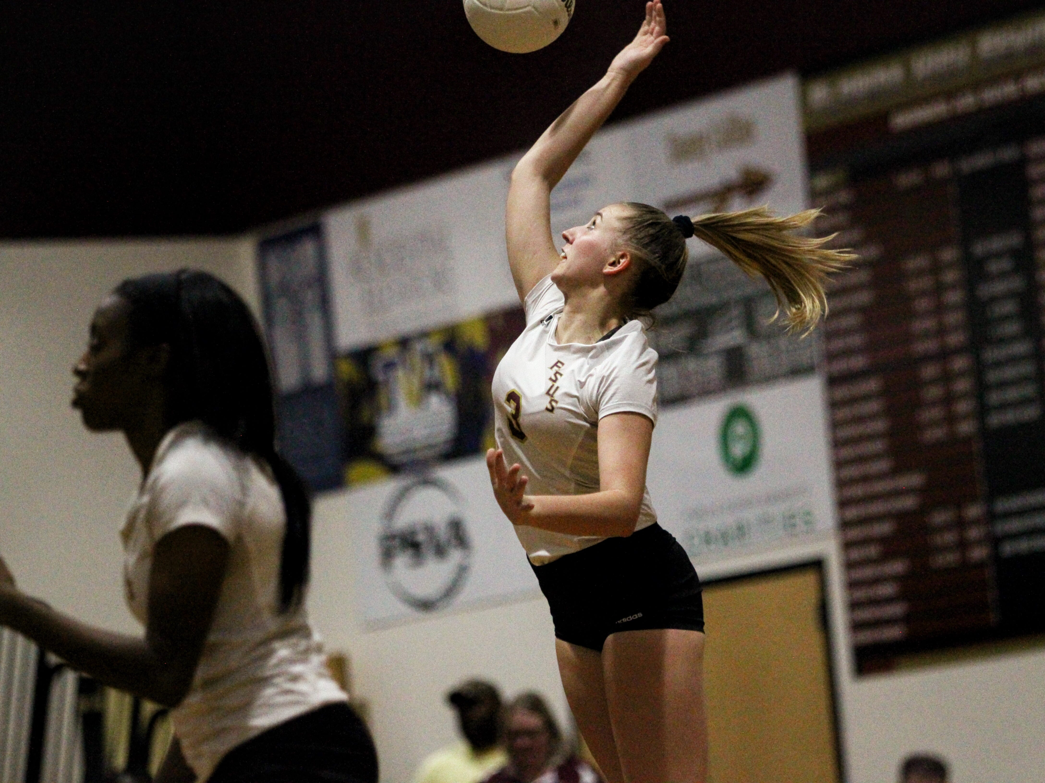 Florida High's Carlee Allbaugh serves during the Seminoles' win over Wakulla.