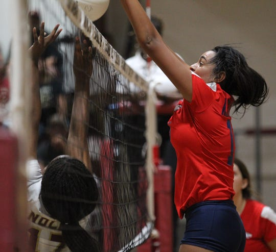 Wakulla's Emilee Brown comes up with a block on Florida High's setting pass during a game last fall.
