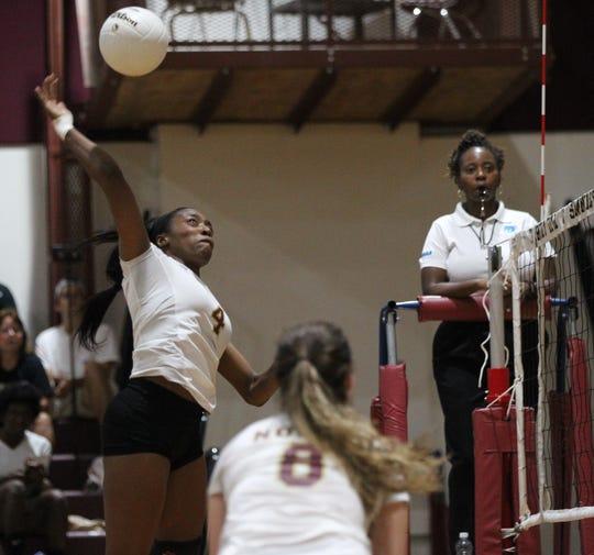 Florida High outside hitter Jada Rhodes goes up for a kill as the Seminoles beat Wakulla 3-2 on Thursday, Sept. 27, 2018.