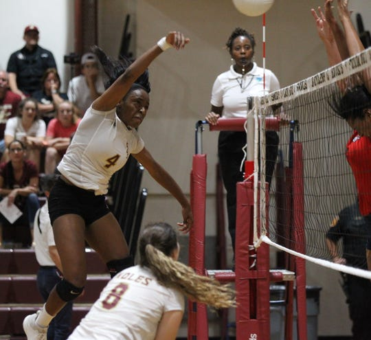Florida High junior outside hitter Jada Rhodes slams a kill during the Seminoles' 3-2 win over Wakulla on Thursday.