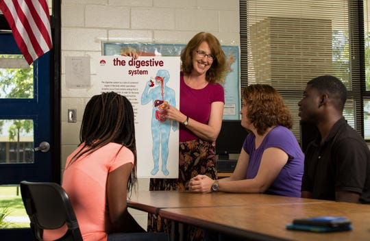 GED® Teacher Anne Meisenzahl teaches a science lesson to help prepare Adult & Community Education School (ACE) students to pass the science section of the GED® Test. Meisenzahl is a long-time teacher with ACE and will be teaching the school's new GED® Class at Riley Elementary School beginning Oct. 1.