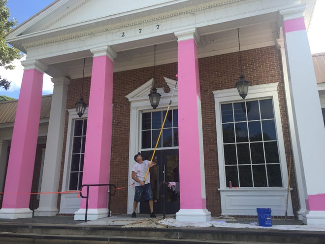 The Tallahassee Democrat pillars get an annual coat of pink paint in preparation for Breast Cancer Awareness month.