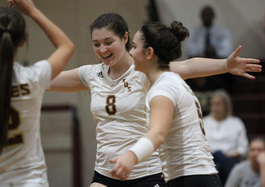 Florida High senior Brooklyn McLeod gathers her team for celebration of a point as the Seminoles beat Wakulla 3-2 on Thursday.