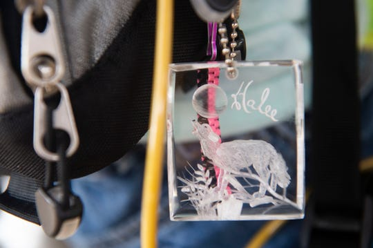 """Halee Doud, 8, of Vero Beach, has a keychain with her favorite animal, an arctic wolf, tied to the backpack that houses her feeding tube. Doud loves animals, reading and giving back to others. """"I love making people happy because it makes me happy,"""" Doud said."""