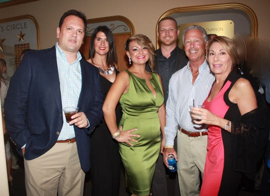 Enjoying the sponsor cocktail reception are top sponsor Josh Birmingham, left, of Premier Private Jets, and Lisa Birmingham, Cheree Ramirez, Jeff Lee and Chuck and Kim Mack.