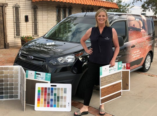 Linda Leach, owner of Floor Coverings International's El Paso franchise, in front of her mobile flooring showroom.