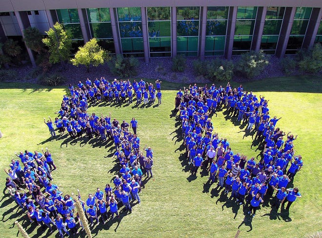 Helen of Troy employees celebrate the company's 50th anniversary in 2018 by forming the number 50 outside its West El Paso headquarters.