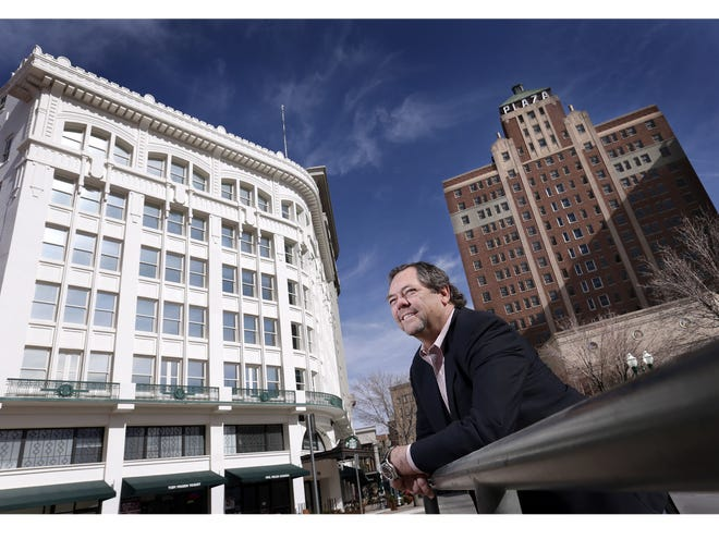 El Paso businessman Paul Foster outside the Centre Building and Plaza Hotel building, both of which he owns.