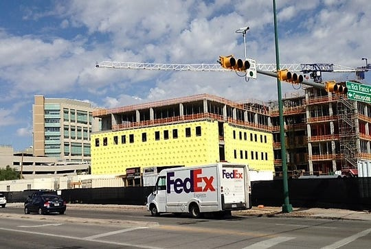 The $83 million Texas Tech Medical Sciences Building II is under construction at Alameda Avenue and Raynolds Street on the Medical Center of the Americas campus in Central El Paso. El Paso Children's Hospital is in the background.