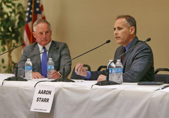 Oxnard Mayor Tim Flynn, left, listens to his opponent Aaron Starr as he answers one of the questions from the public during the second League of Women Voters forum Thursday at the South Oxnard Senior Center. Missing from the debate was fellow candidate Mario Quintana.